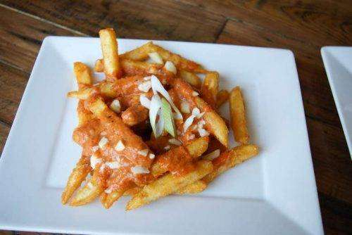 Butter Chicken Poutine - Bombay Grill Milton